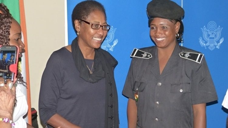 Ambassador Reddick with a Police Women.